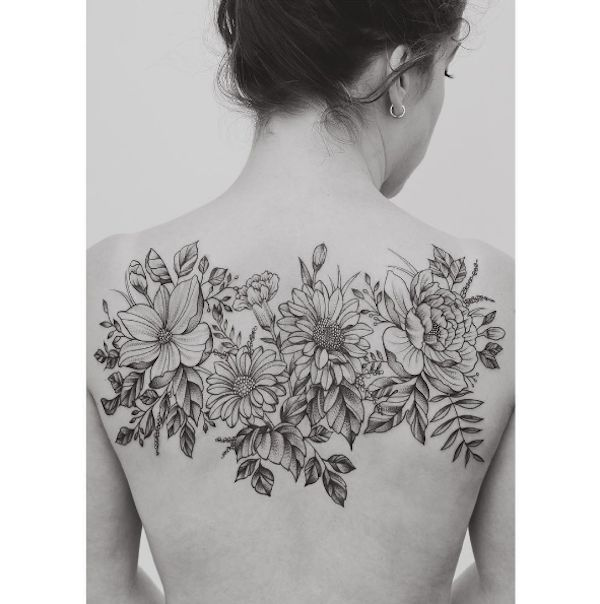 Image result for middle back flower tattoos