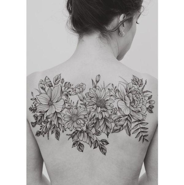 Image result for middle back flower tattoos