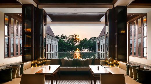 As the sun sets, the curtain rises on the night, illuminating spectacular views of the waterfront and the grandeur of the Indo-Portuguese palace at Grand Hyatt Goa.