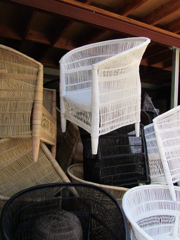 Stacks of Malawi chairs! Black, white, and natural.