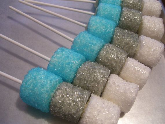 Sugar Coated Marshmallow Pops ~ 1 dozen  NOTE: They are not coated in Chocolate... However...(There is a dot of chocolate at the end and in between each marshmallow to hold them together). The White / Silver / Blue were done for a Frozen ~ Winter Wonderland Theme   Let me know what color you would like... and what color(s). You will receive 12 (one dozen) Sugar Coated Marshmallow Pops on a Stick. Not the chocolate lover, no worries, they are Sugar Coated. (There is a dot of chocolate in…