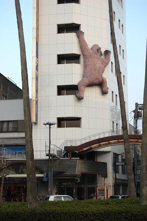 king kong climbing a tokushima building