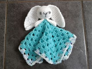 Here is my pattern for a cute bunny comforter, with lovely long ears and a cuddly granny square blanky, it's soft and easy for little hands to hold. To save tears if it ever gets lost, you may have to make two! FREE PDF 1/15.  ~ LINK CORRECT and pattern is FREE when I checked on 04/04/2015.