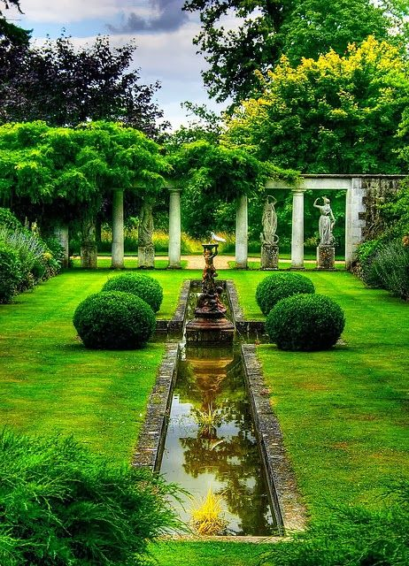 Formal garden with statues and pillars.  #formalgarden homechanneltv.com
