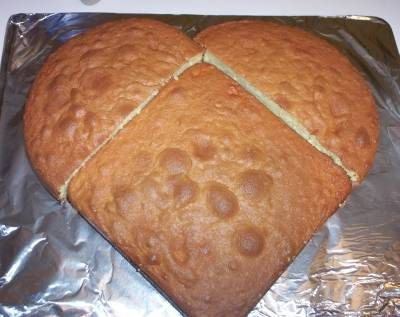 You don't need a special pan to make a heart-shaped cake – just pour the batter of your favorite cake mix into one 8-inch square cake pan and also into one 8-inch round cake pan. Bake. Once cooled, slice the round cake in half so that you have two equal semi-circles. Create a heart by placing the round halves on each side of the square cake.