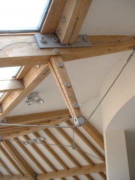 Green oak bow-string truss/by Roderick James Architects