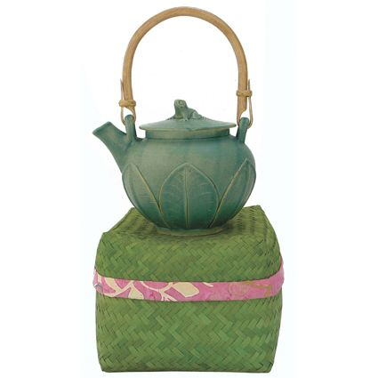 Celadon ceramic tea pot with leaf motif and perched frog top is presented in a hand woven bamboo basket.  Handcrafted by fair trade artisans in Bali, Indonesia. Price: $65.00 Olina Faire... a World of reasons to Party! www.olinafaire.com
