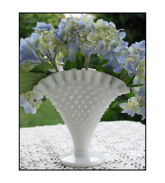 Add a touch of Cottage Chic with this diminutive 4 1/4 tall fan vase by Fenton. Its mouth measures 4 x 1 1/2 wide. Adorned with sweet milk glass hobnails, this beauty is in LOVEly vintage condition.