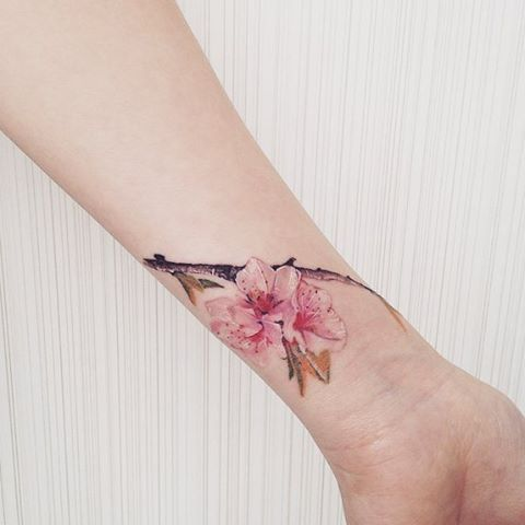 We love Sakura  #tattoo #flowertattoo #sakuratattoo #cherryblossomtattoo…