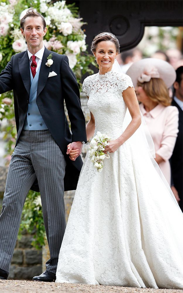 Kate Middleton just wore a dress that resembles both her and Pippa Middleton's wedding dresses. See it here.