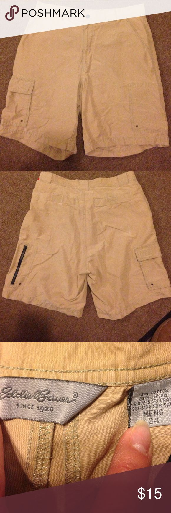Eddie Bauer shorts. Men's Sz 34 Eddie Bauer shorts. Men's Sz 34. 78% cotton. 22% nylon. Khaki color. 2 back pockets with Velcro fasteners   2 front side pockets. 1 small pocket with Velcro fastener.   Pocket on the side of each leg. One has zipper closure   One has flap with Velcro faster. Zipper fly with snap at waistband.  Nice shorts! Eddie Bauer Shorts