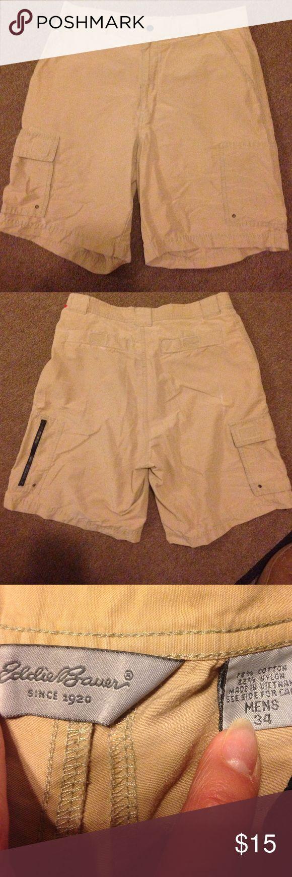 Eddie Bauer shorts. Men's Sz 34 Eddie Bauer shorts. Men's Sz 34. 78% cotton. 22% nylon. Khaki color. 2 back pockets with Velcro fasteners   2 front side pockets. 1 small pocket with Velcro fastener.   Pocket on the side of each leg. One has zipper closure   One has flap with Velcro faster. Zipper fly with snap at waistband.  Nice shorts! Eddie Bauer Shorts