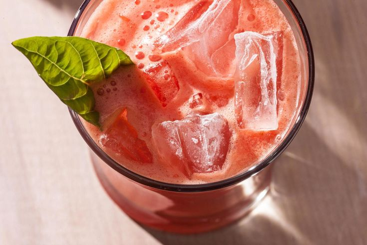 An easy and refreshing summer recipe with tequila, watermelon, lime juice, and agave nectar blended together and served over ice. Perfect for Cinco de Mayo!
