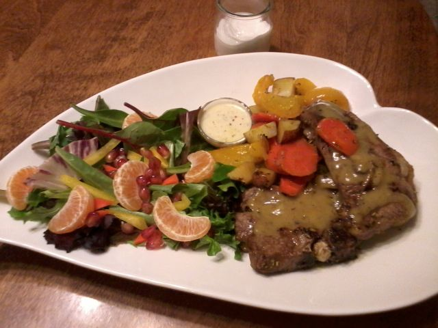 braised lamb shoulder with veggies and salad