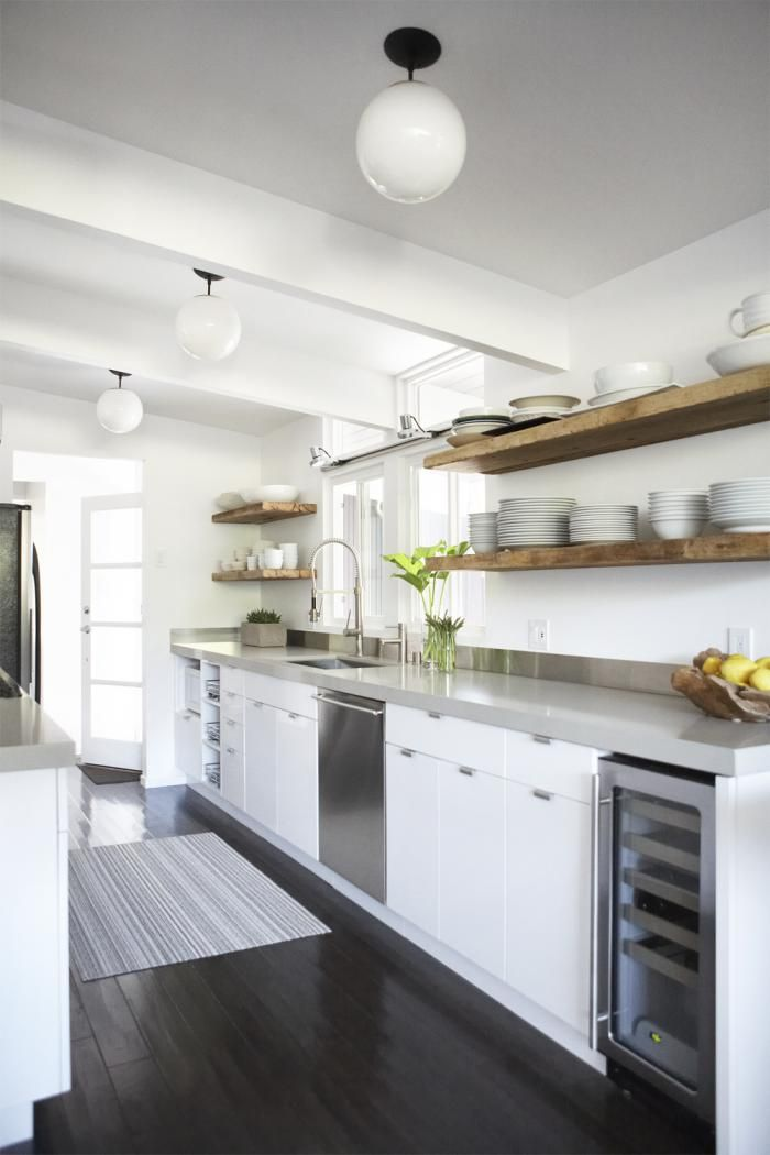 wooden open shelves, gray counters