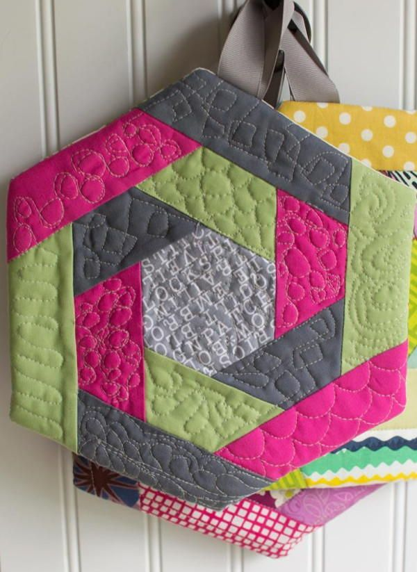 These Hexi Log Cabin Potholders would make a great homemade gift idea. They'd look great in any kitchen!