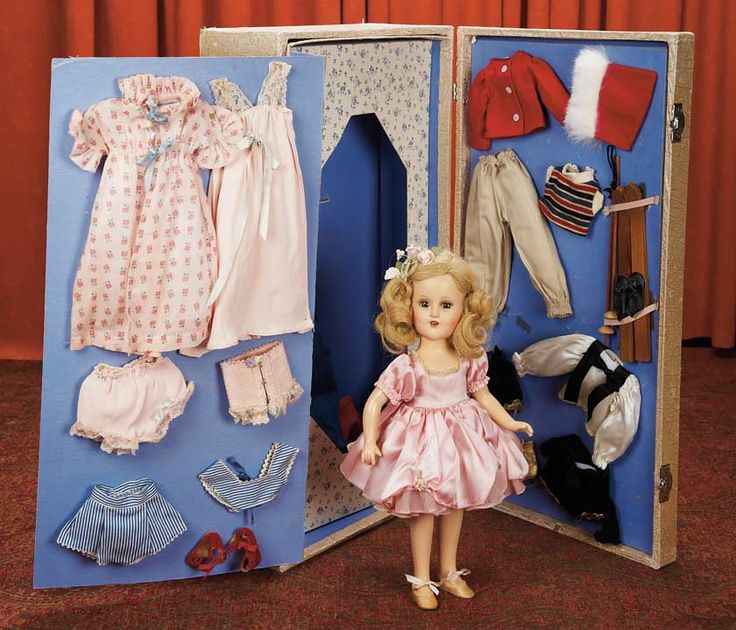 """American Composition """"Sonja Henie"""" by Alexander with Presentation Trousseau  14""""(36 cm.) All-composition doll http://www.theriaults.com/images/1102/Cat-1102_425.jpg"""