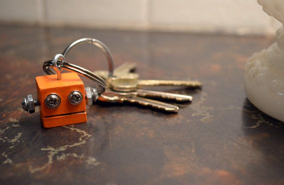 THE cutest little robot keychain... called a robotic key guardian, to keep your keys safe. :D Cute for a child's house key ♥