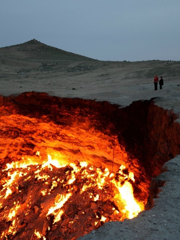 """While drilling in 1971 in Derweze (in the middle of the Karakum Desert), Soviet geologists tapped into a cavern filled with natural gas.  The ground collapsed, leaving a 230-ft hole.  To avoid poisonous gas discharge, they decided to let it burn off (thinking it would be a matter of days).  It's still burning today, earning the nickname """"The Door to Hell""""."""