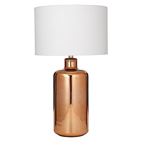 Resplendent copper colour within the Evie Table Lamp from Amalfi brings a warming glow to your luminous living room.