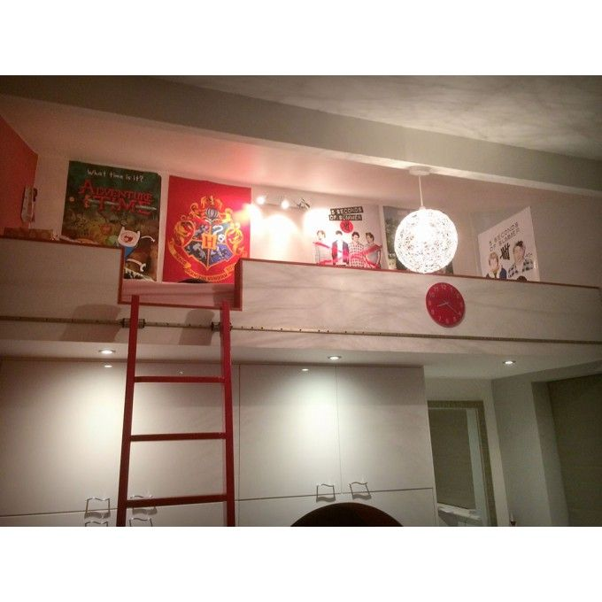 A bespoke Rolling Ladder for a mezzanine bed in a child's bedroom.