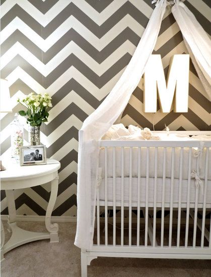 Room Overview A chevron wall set a modern tone for the nursery. To ensure that the stripes weren't overpowering, Jillian set the DucDuc Stonington Crib ($1,700) and Arteriors Home End Table ($864) on the same wall. The two pieces of furniture toned down the boldness of the wall. Source: Dana Valeria for Jillian Harris Design, Inc.