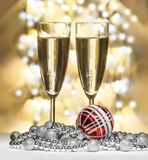 Red christmas sphere, wine glasses Royalty Free Stock Image