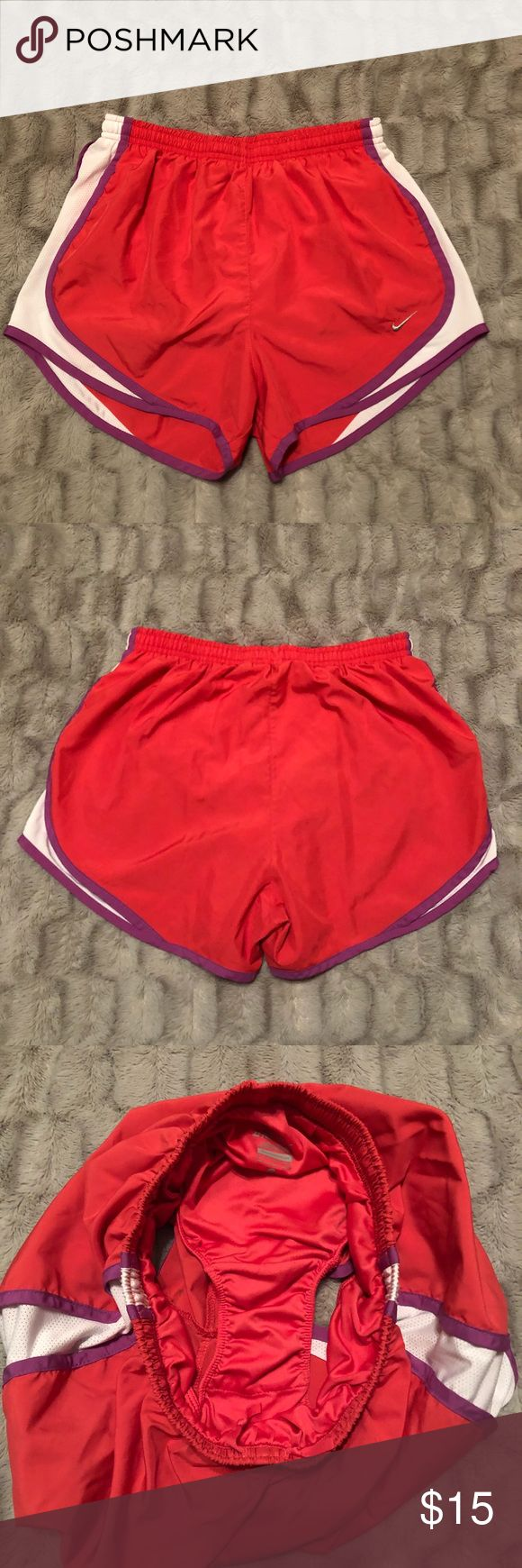 Nike Tempo Shorts These ever so popular Nike tempo shorts are in excellent condition.  Like new, these shorts will make you run fast, jump higher, and feel comfortable!  Item is slightly more pink than it appears in the photo.  Built-in interior still present, never worn without undergarments. Nike Shorts