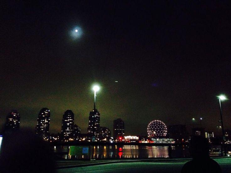 The moon and science world across false creek