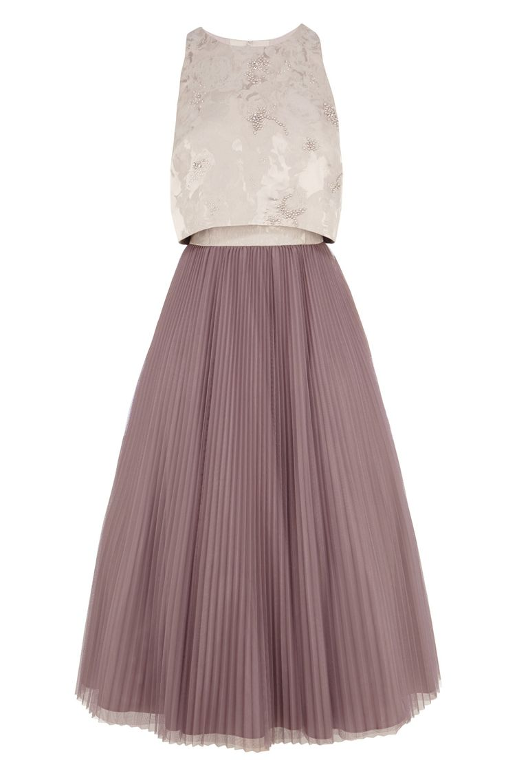 The Harven Dress is a classic piece with its flattering cut and beautiful beading at the bodice. Featuring a cropped jacquard overlay and pleated skirt, the dramatic flared skirt comes complete with an underneath tulle which creates a stunning silhouette. This style is closed with a concealed back zip and a hook at the nape. From neck to hem dress length is 45 inches/ 114cm. Height of model shown: 5ft 9inches/175cm. Model wears: UK size 10