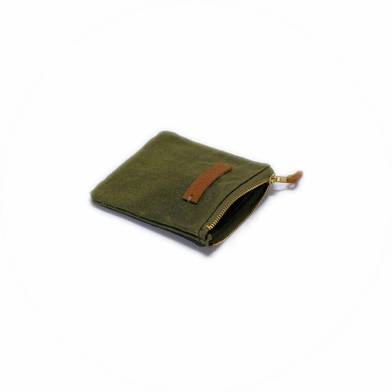 Waxed canvas pouch, cosmetic bag, mini zipper pouch  • Handmade product • Material: drawn, old, handwaxed military canvas • Size: 9cm/3.5 width, 11cm/4.3 height   In this shop you can find handmade, unique products. I reuse old military truck canvas, dufflebags, and various bags as materials. I select and clean them with extra carefulness. The quality of these materials are extraordinary, and thus the product made from them serves the costumer for long-long years. It is my goal to use the…