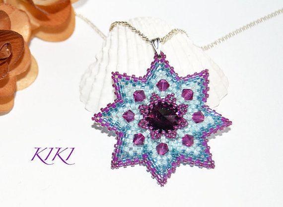 Beaded flower star pendant with amethyst bezeled swarovski rivoli crystal and swarovski bicones unique beadwork made with peyote technique