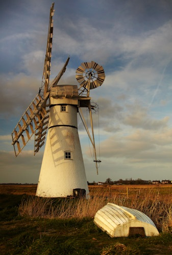 Thurne Sunset at the beautifully preserved windpump of Thurne in the Norfolk Broads. by Chris Shepherd