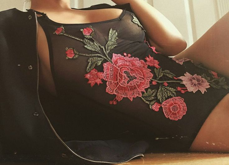 Embroidery on black mesh