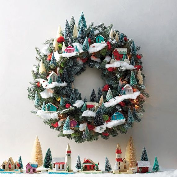 Create a charming winter wonderland scene with tiny cardboard houses and bottlebrush trees -- they're a cinch to spruce up for the season.