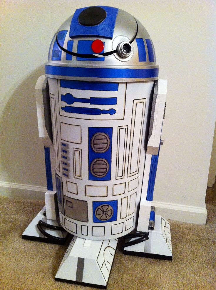 R2D2 Trash Can -made from a plastic trash can, orthotic foam, aluminum pieces, spray paint, nuts, bolts, plumbing tubing, paint, aluminum petri dish, wood, nails and lots and lots of labor