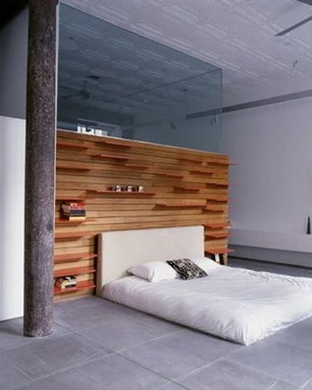 bedroom with timber wall bedhead