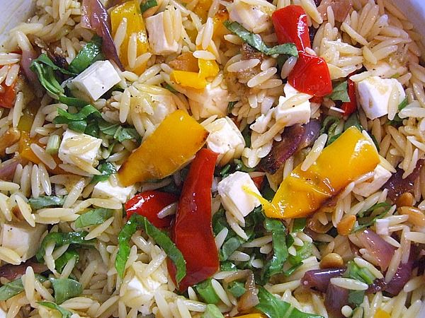 "Ina Garten's Orzo with Roasted Vegetables recipe - ""...veggies were added to cooked orzo and tossed with a lemony dressing. Add scallions, toasted pine nuts, fresh basil and CHUNKS of feta (not crumbled) and you've got yourself a side salad."""