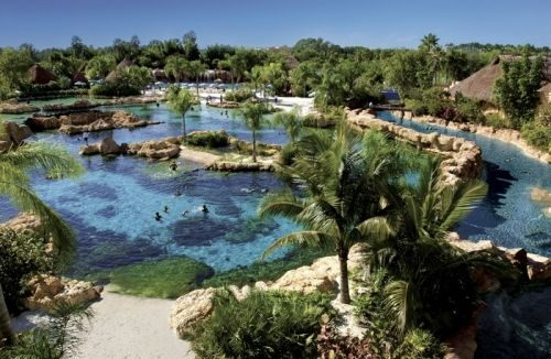 Share Tweet + 1 Mail Discovery Cove, a SeaWorld-owned property located directly across the street from the main entrance of SeaWorld Orlando, is definitely ...