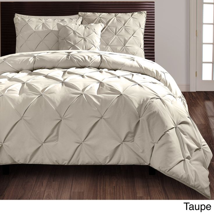 Beautify your bedroom with this sophisticated four-piece comforter set. A puckered diamond design embellishes this contemporary set for your king or queen-size bed. Available in grey, white, and taupe, this set will easily match your current decor.