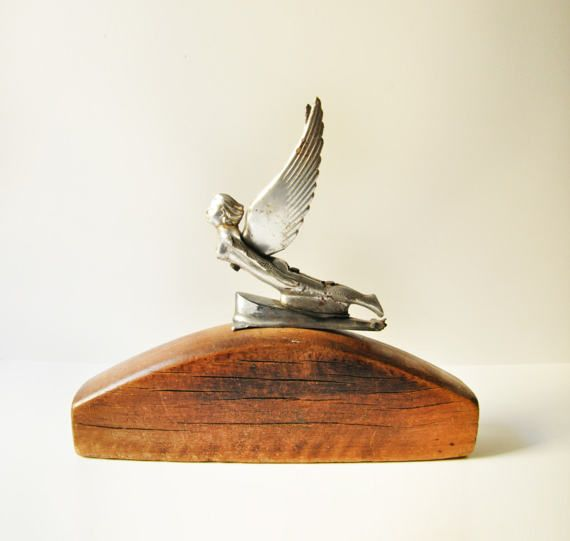 Stunning, very hard to find genuine vintage car hood ornament in the form of a flying lady angel.  Made of cast chromed metal this car emblem is a true eye catcher, full of vintage character and genuine aged patina.  Dimensions: Width 16 cm Height 24 cm  The wooden base in photo 1 is used for decoration purposes only and is not included with purchase.  - - - - - - - - - - - - - - - - - - - - - - - - - - - - - - - - - - - - - - - - - - - - - - - - - - - - - - - -  Please take a closer look at…