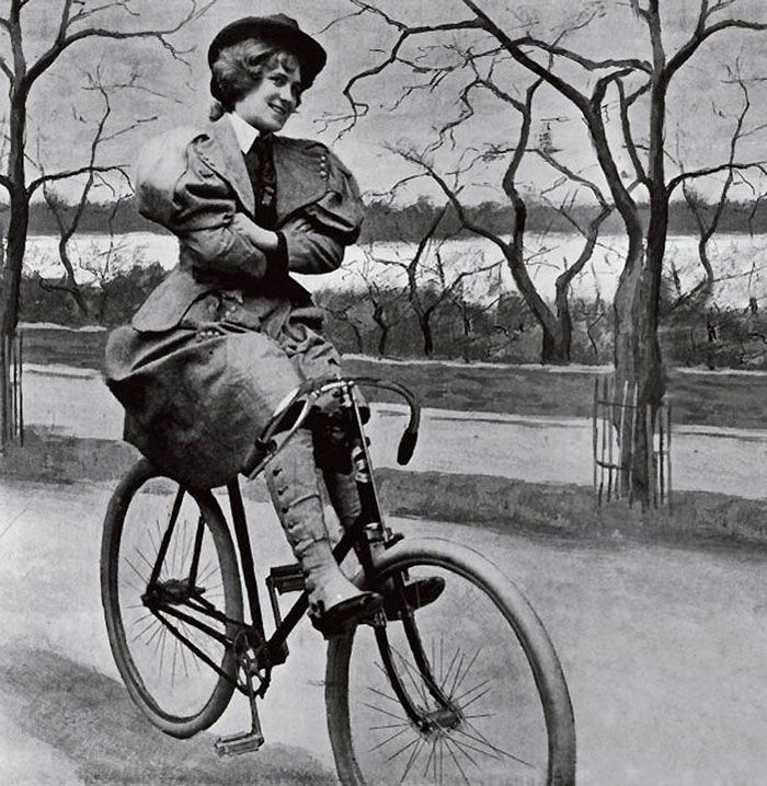 A Woman Riding Scorcher Victorian Bicycle In St James