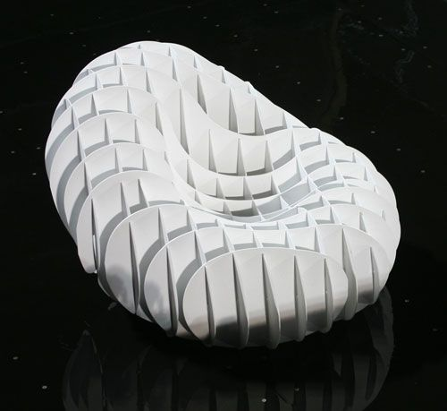 Serbian designer Marko Runjic of Rudesign created the lightweight, 22-segment Karsa chair. The concept reminds me of the divided, intersecting inserts that go in boxes to separate stuff. With 11 segments going one way and 11 going the other way, the chair is completely sturdy when stretched out.: Chairs Shared, Rudesign Create, Karsa Sofas 2 Jpg 500 459, Karsa Chairs, Serbian Design, Marko Runjic, Simple System, 22 Segmenting Karsa, Design Marko