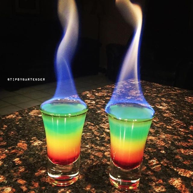 FLAMING RAINBOWS Grenadine Orange Juice Vodka Club Soda Blue Food Coloring Bacardi 151 Instagram Photo Credit: @louthebartender Post your original recipe and photo on Instagram using #TipsyBartender and we will repost the best ones. Each month, the pics with most likes wins $300, 2nd Place $200, 3rd Place: $100. #vodka #cocktail #drink #vodka #rum #rainbow #fire