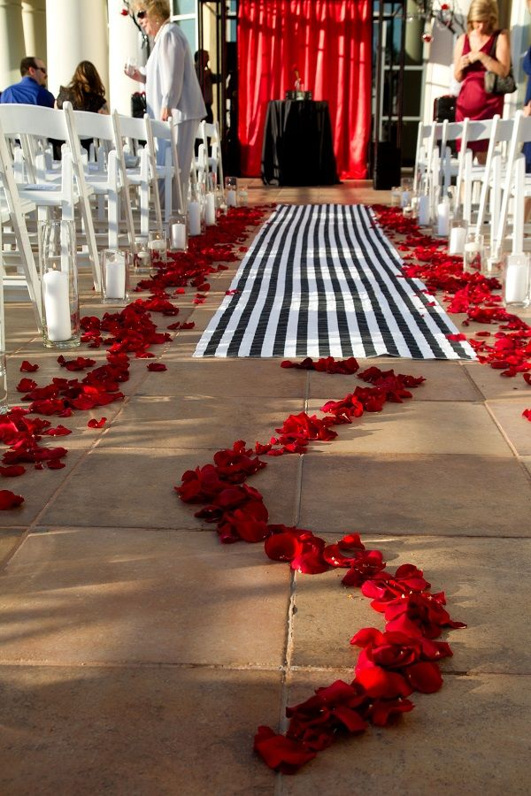Striped aisle runner and deep red rose petals, perfect for this punk rock wedding! | Canyon Gate Country Club from Red Velvet Weddings | Featured on Little Vegas Wedding