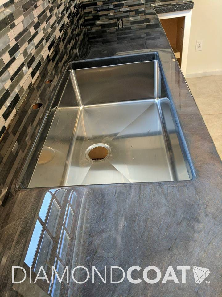Looking For Something Simple Yet Modern Grey With Pearl Countertops Are The Way To Go Epoxy Countertop Kitchen