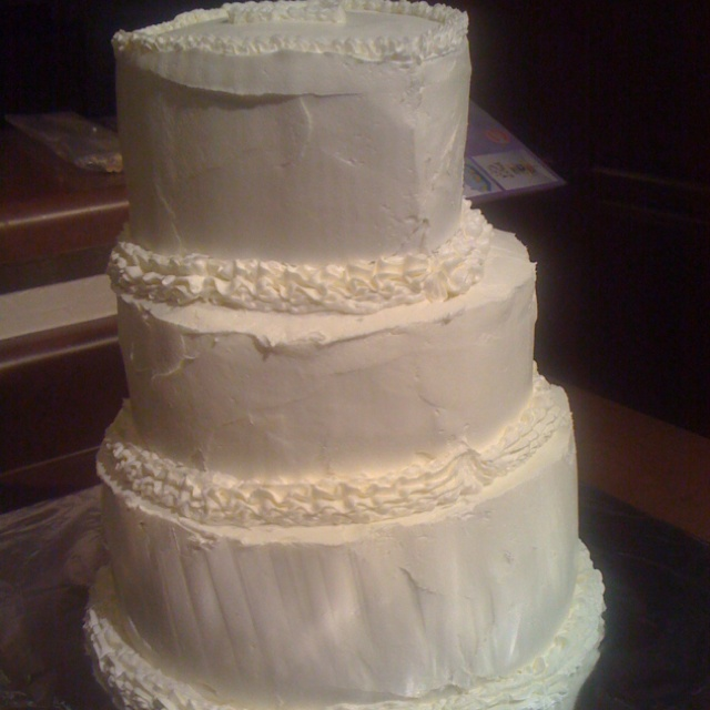 My mom's wedding cake, which I cheerfully made for her second marriage - not bad for a first try.  It's a combo of white and chocolate tiers with orange blossom buttercream filling. (I also performed the ceremony!)