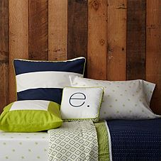 Sprout & Navy coordinating bedding, with red chevron