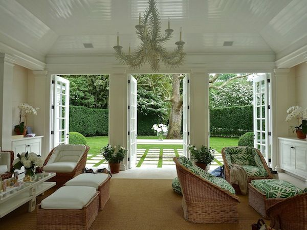 Aerin Lauder again, a superb pool-house with French doors, casually elegant  furniture and a die-for outlook. Gloss white ceiling and an informal  chandelier ...