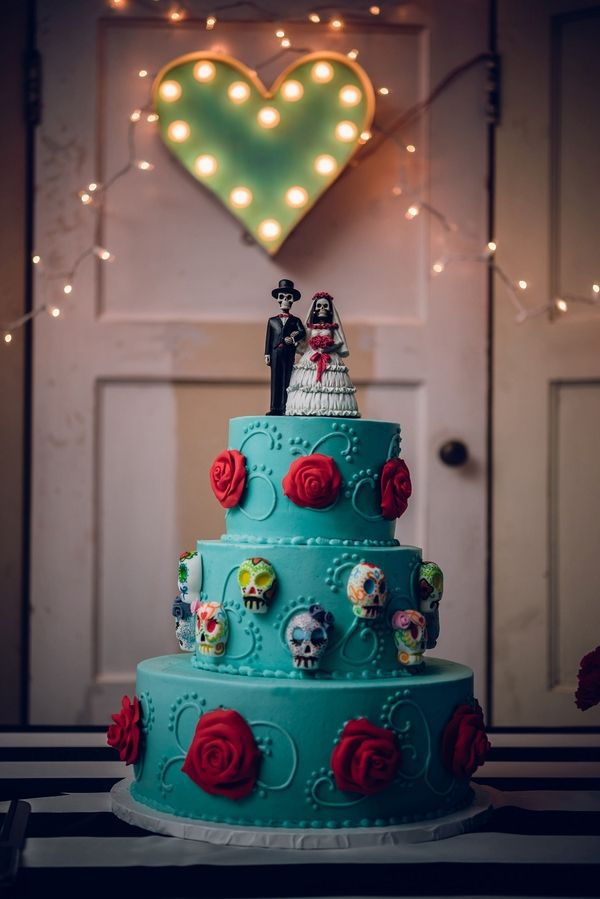 Celebrate with a colorful skeleton bride and groom  @myweddingdotcom